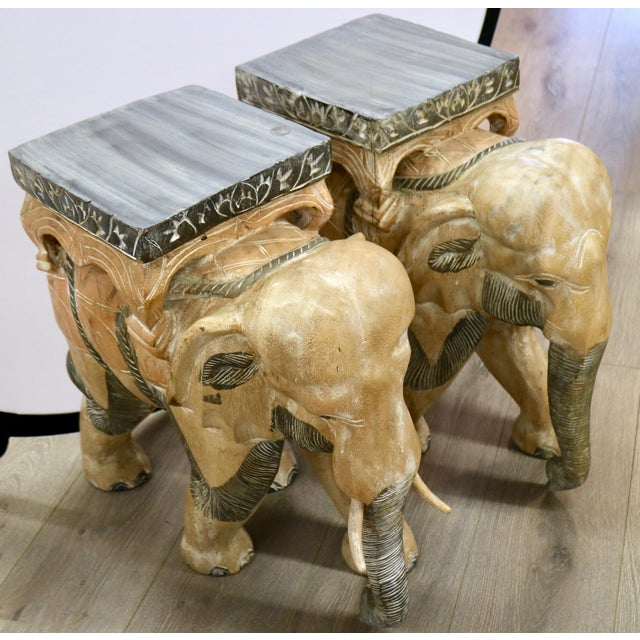 This Pair of Carved Wood Elephants are made with stunning detail. However, one of the elephants is missing both tusks :(...