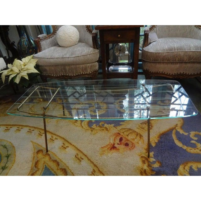 Outstanding Italian Gio Ponti style bronze or brass cocktail table with an unusual etched glass top, circa 1960. This...