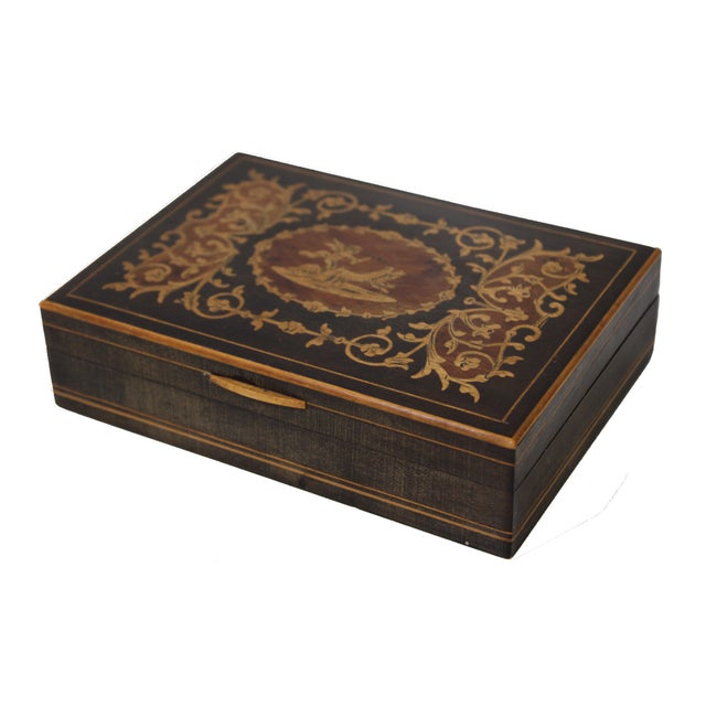 Antique 19th Century French marquetry wooden box. Cherub leading horses scene finely inlaid with fruit wood. The box was...