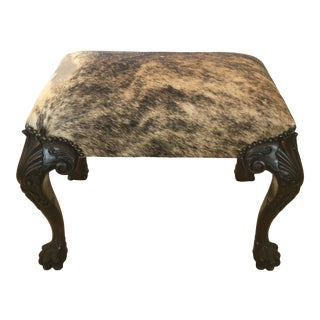 Antique Carved Mahogany and Cowhide Ottoman For Sale