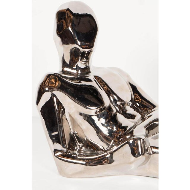 This Mid-Century Modernist figurative sculpture in nickel plated ceramic was executed by Jaru of California in the...