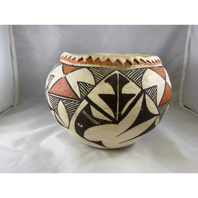 Wonderful hand built polychrome pot with unique geometric painted design. Lip of jar features raised design. Intricate and...