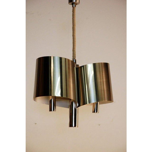 Chic French, 1970s polished chrome ribbon chandelier by Maison Charles. Adjustable height. Matching canopy.