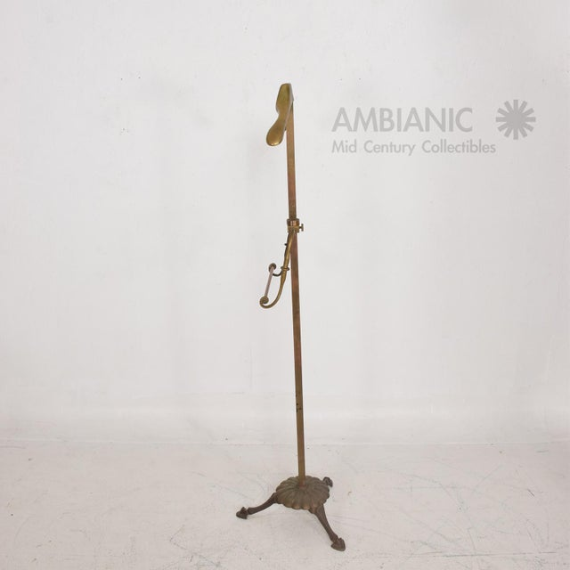 "For your consideration a vintage gentleman's valet in brass. Original vintage patina. Measures: 55"" H x 17"" W x 13 1/2"" D."