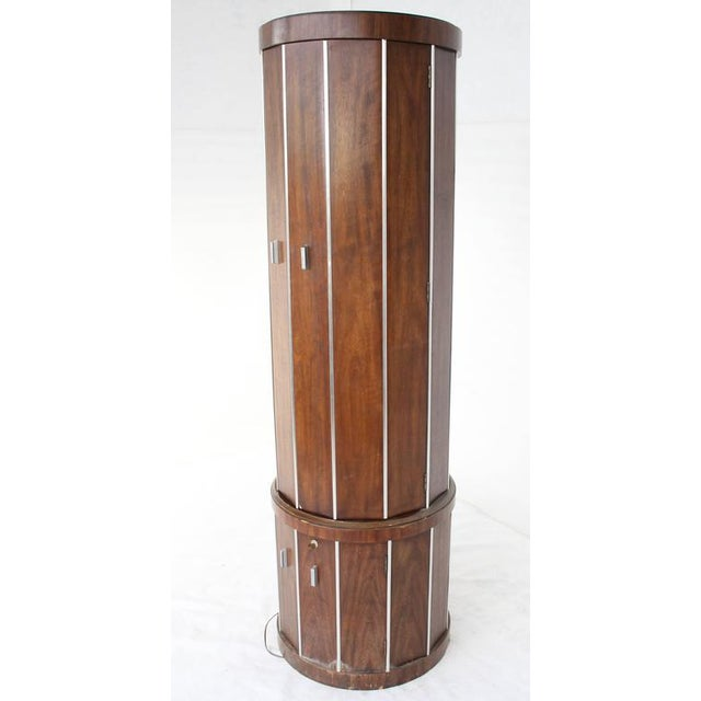 Mid-Century Modern cylinder drum shape walnut liquor cabinet. Rare cabinet in as is (minor damage as pictured) condition.