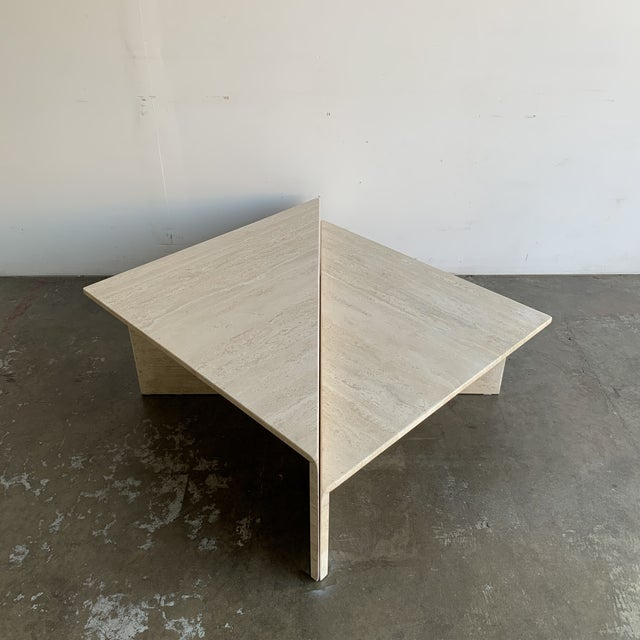 Now available is a pair of 20th century triangular coffee tables. These are solid travertine, feature modular options,...