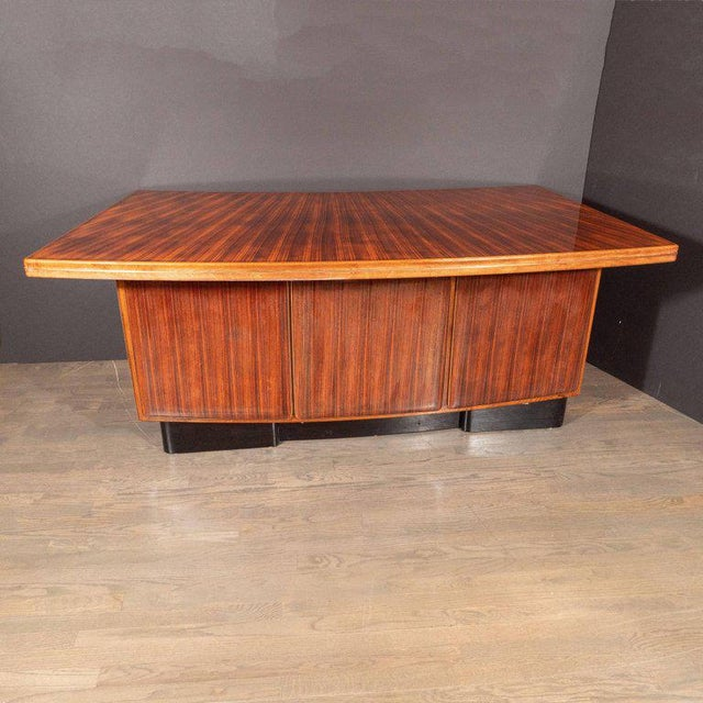 This stunning and elegant desk was realized in the United States, circa 1940. Composed of a classic streamlined bow front...