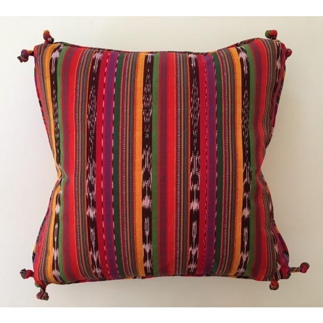 Custom made pair of Guatemalan striped pillows with decorative self knots at the corners. The colorful striped fabric will...