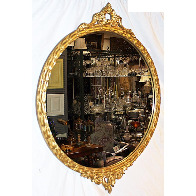 A rare round rococo-style American gesso-on-wood framed 1930s gilt mirror, original glass, frame just buffed with a French...