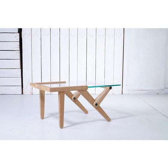 Made in Europe. Wood specie: Solid Elm Wood Top: Tempered glass Here is a coffee table comprised of Elm wood, glass, and...