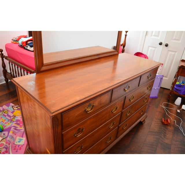 Kindel Grand Rapids 9 drawer dresser with attached mirror on the back. Good condition with some wear on the top of the...