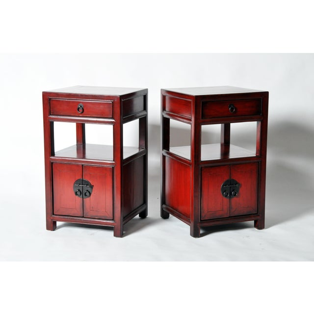 This pair of Chinese bedside chests is made from elmwood and has been fully restored. They each feature a drawer and...