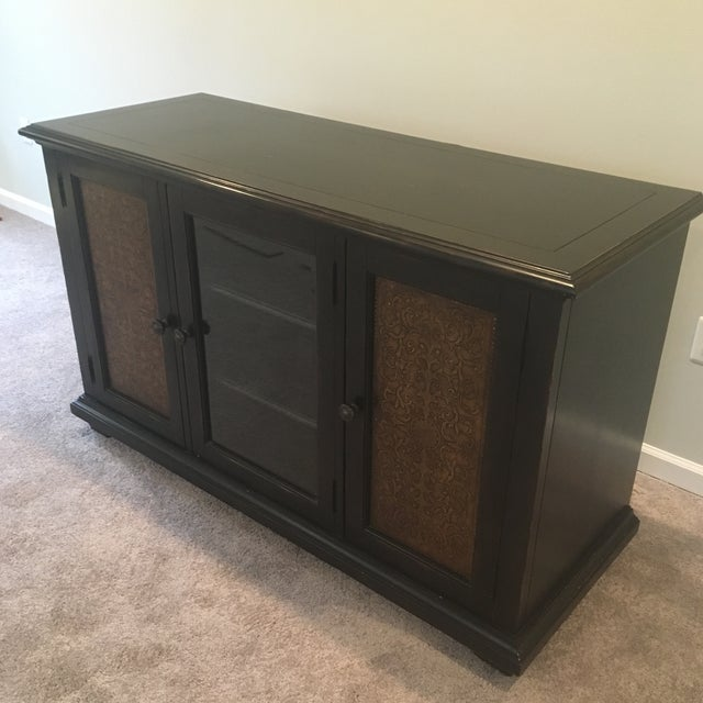Credenza / Media Cabinent. Approximately 60in x 23in x36 in Tall. 3 cabinents that each open to 3 shelves with openings...