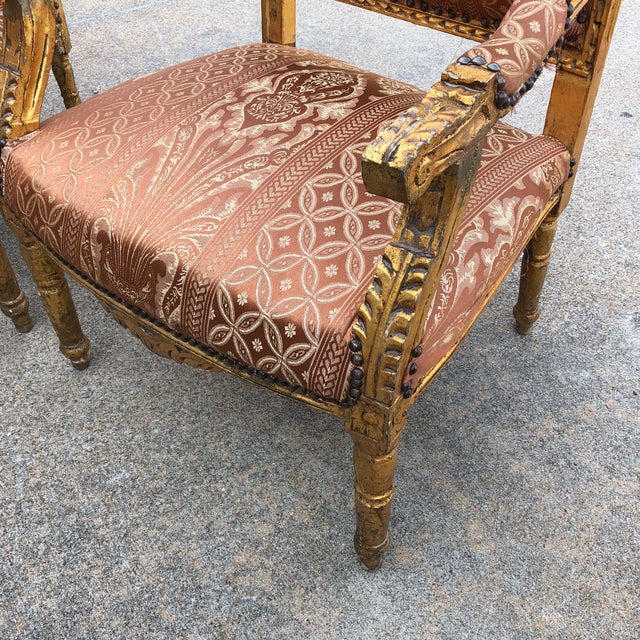 This is a beautiful collection that includes 1 gilded sofa and 2 chairs with nailhead trim and the damask upholstery. The...