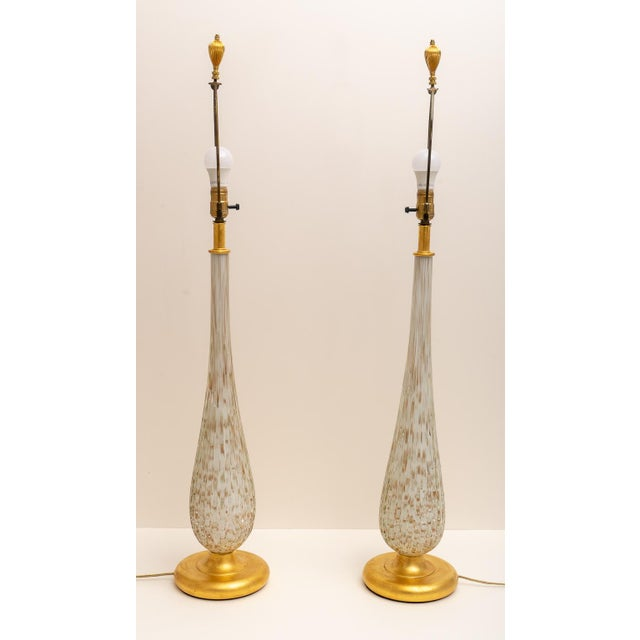 This stylish set of Murano glass tables lamps were acquired from a Palm Beach estate and they will make a definite...