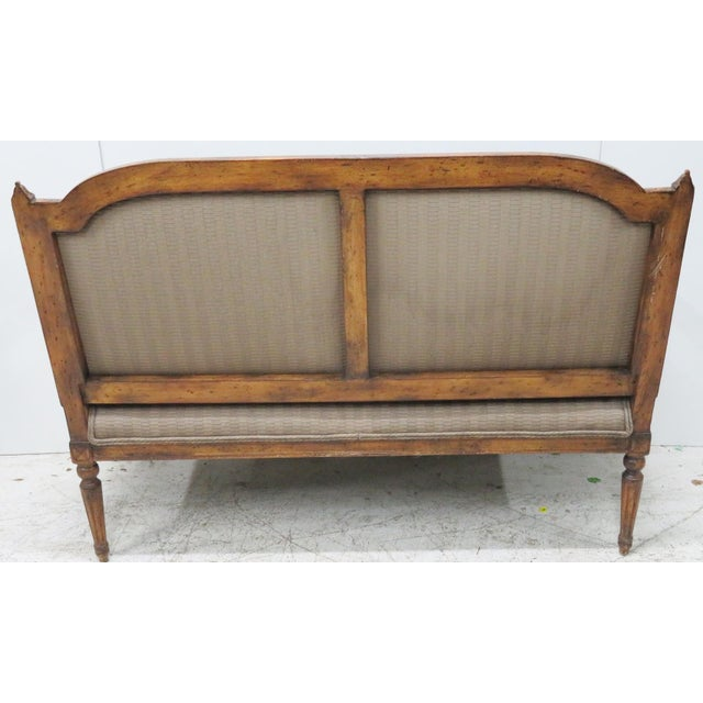 "Carved frame. Striped tufted upholstery. Seat height 18""h."