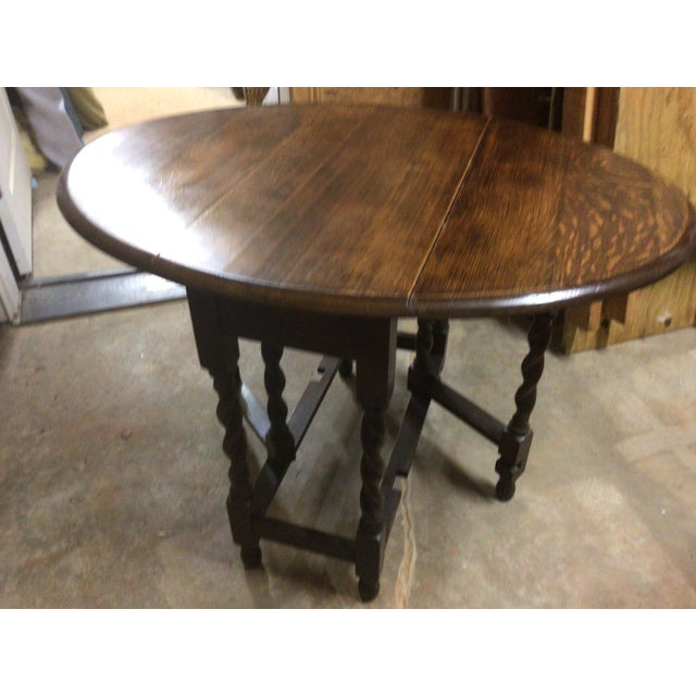 Lovely small English Oak gate leg table. Could be used as an end table or console when folded, or a lovely small tea table...