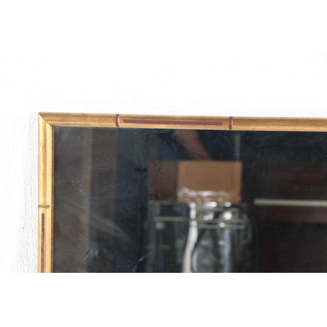 A pair of large giltwood faux bamboo wall mirrors in great condition. D-rings fastened to the backs for both horizontal...