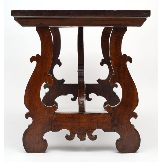 """Solid walnut antique Spanish Renaissance """"Lyra"""" Trestle table, finely hand carved base featuring two Lyra pedestals..."""