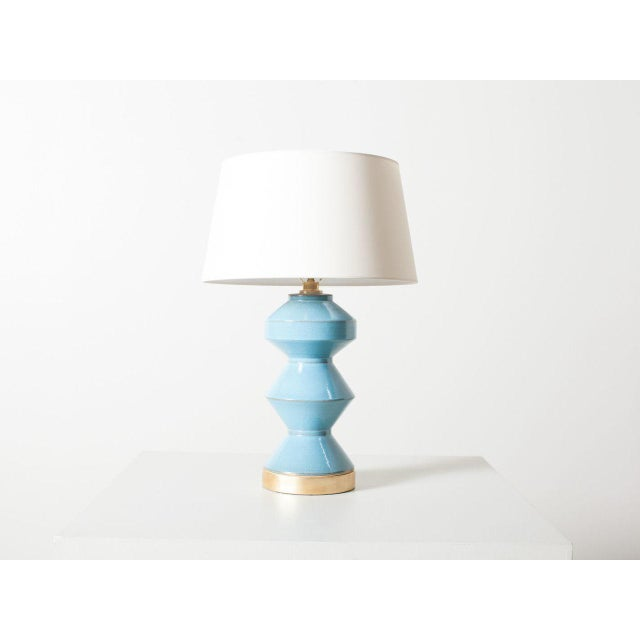 Zig-zag table lamp. Oslo blue with natural paper shade. Dimmer socket: 150w maximum