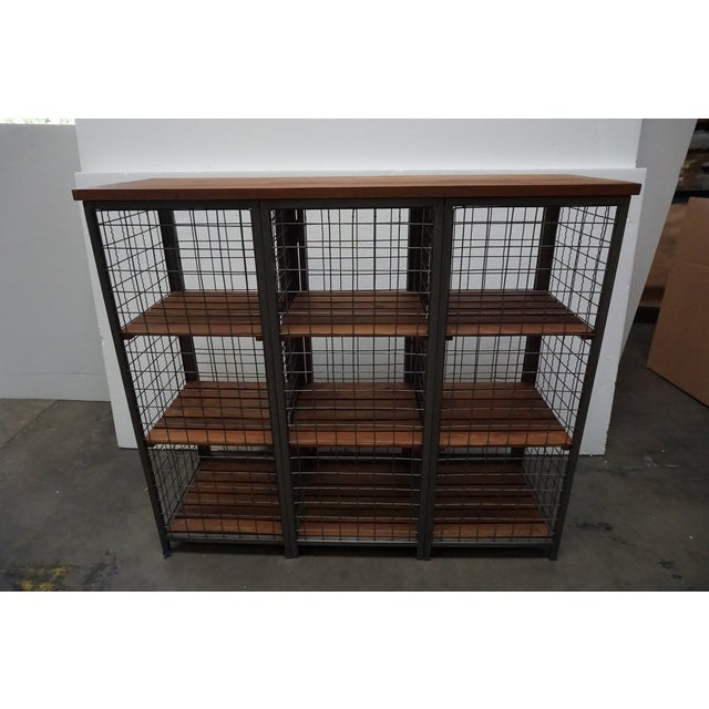 From the personal collection of Shay Mitchell. This unique piece is so versatile. A mesh metal exterior and doors enclose...