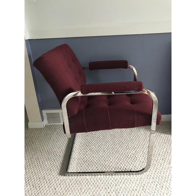Gorgeous Burgundy Milo Baughman Style Chrome Armchair by Patrician circa 1986 with a cantilevered base, tufted seat and...