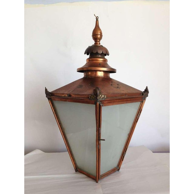 Exceptional antique large hanging light with four lights inside frosted panels and copper structure. Recommend 40 watt...