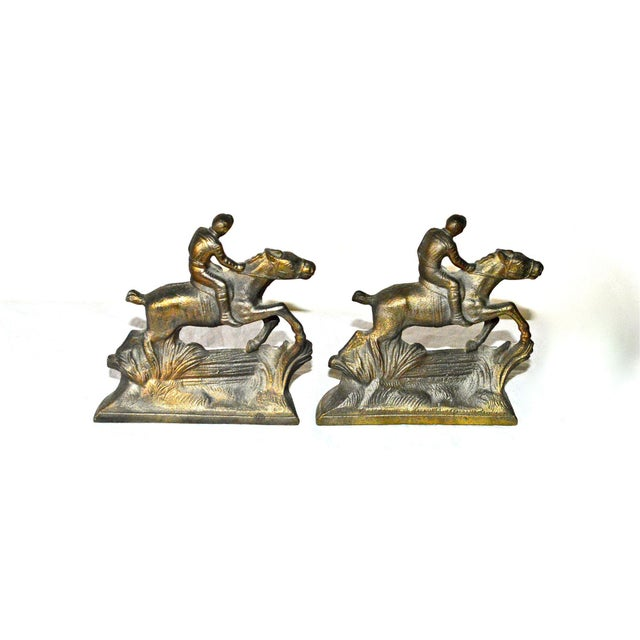 "A pair of 1920s bookends was called ""Whipper In"" by Hubley. Brass-plated iron. Each is 4.75""W x 2.25""D x 5""H. Weight..."