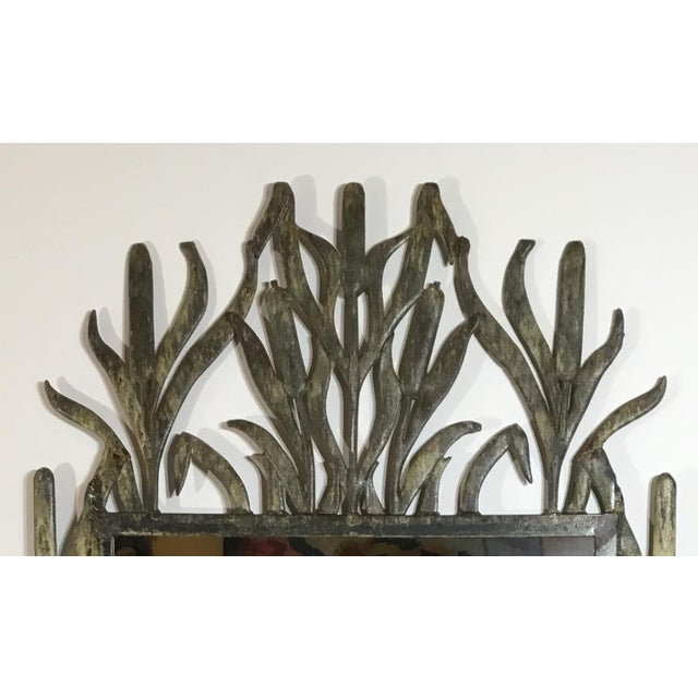 Decorative mirror artistically made of cast iron , unusual cat Tail motif and beautifully enhanced patina treated for...
