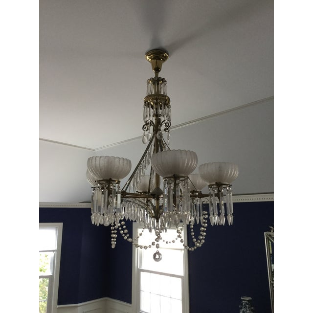 Large brass chandelier that was originally gas but has been converted to electric. There are 6 arms each with an etched...