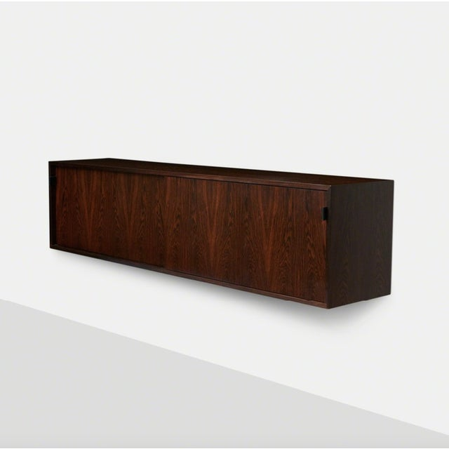 Florence Knoll Floating Rosewood and Leather Credenza A Floating side board designed by Florence Knoll and produced by...