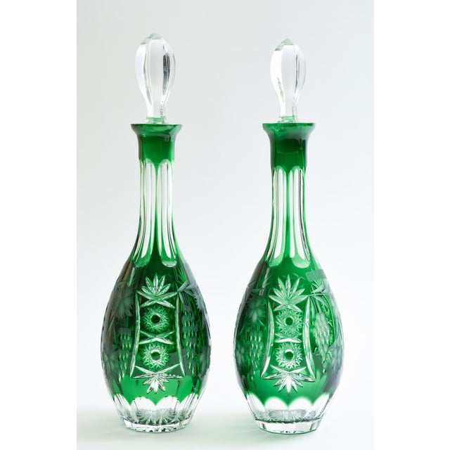 Vintage pair cut crystal barware / tableware drinks decanter with etched exterior design details. Each decanter is in...