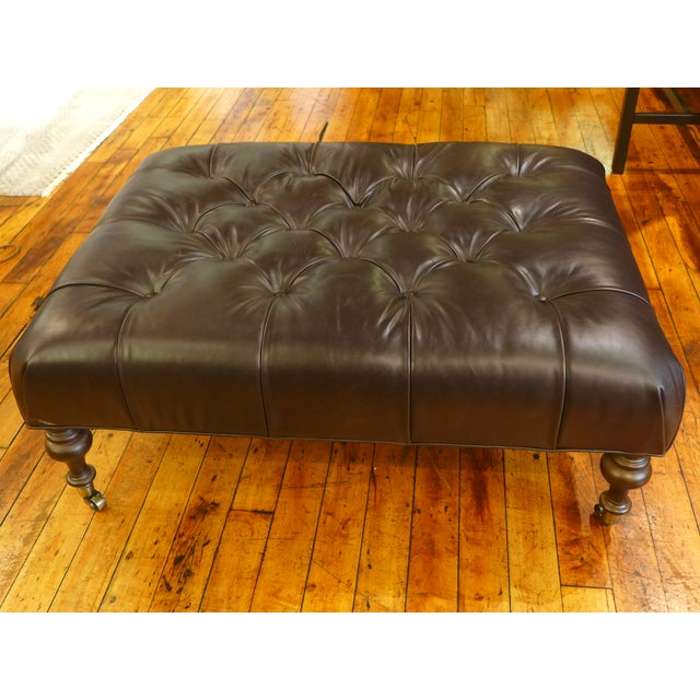 Interesting tufted dark leather ottoman/coffee table combination - very versatile, can provide auxiliary seating and/or a...