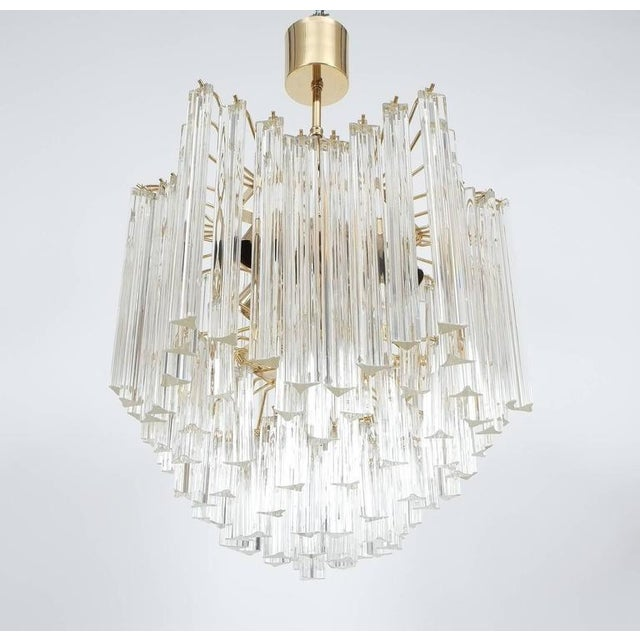 """Beautiful Venini 20"""" chandelier, circa 1970s, with surrounding Murano glass triedri prisms, suspended from a four-tier..."""