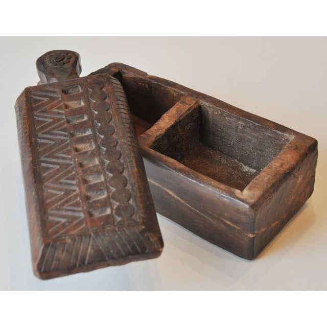 19th century India Rajasthan spice box. Wooden hand-carved with hinged top pivots to open to two compartments.