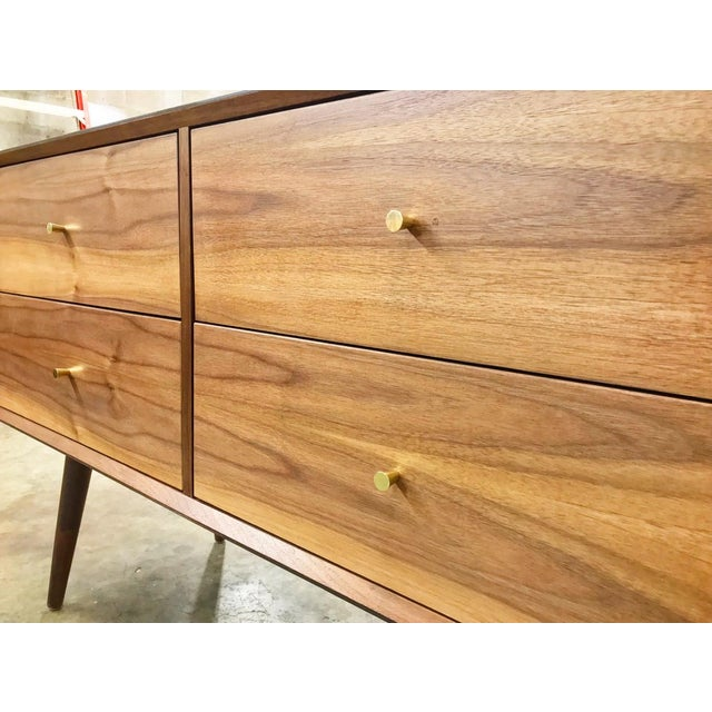 """Gorgeous handcrafted walnut dresser with enhanced grain. Includes 4 storage drawers with brass pulls. Dimensions: 48"""" W x..."""