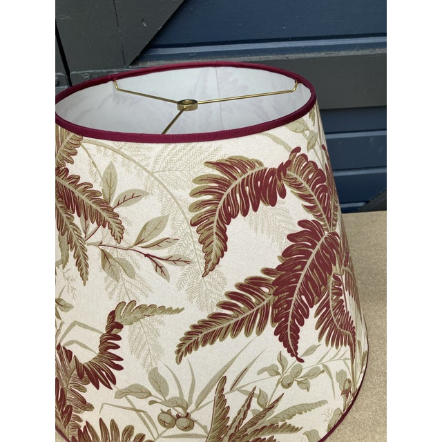 """A lampshade handmade from a fern printed cotton. Measurements: top10"""" bottom 18"""" side 13"""""""