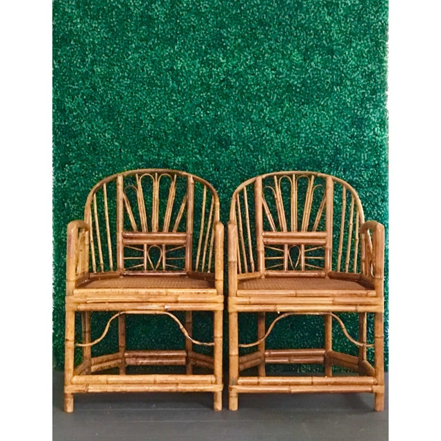 Vintage pair of Bamboo Brighton Pavilion style arm chairs with cane seats and cushions. These have been kept on a sun...