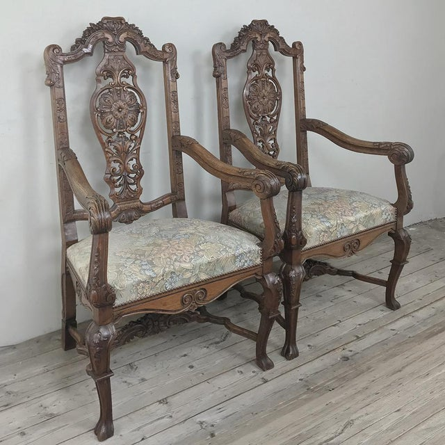 Pair 19th Century Liegoise Louis XIV Armchairs feature amazing detail, all hand-carved to perfection from the boldly...