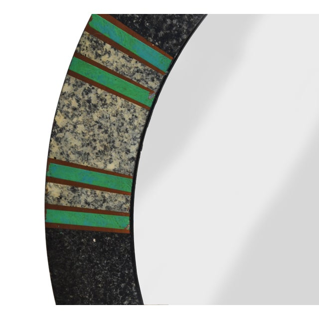 Mid-Century Modern round tessellated mirror painted in green and comes with different shades of gray. Marked on back side...
