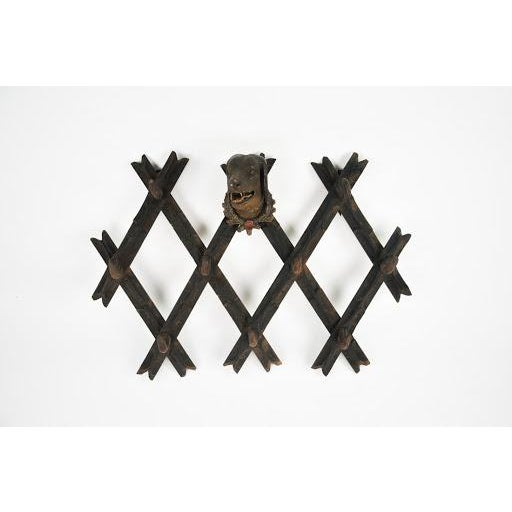 This stunning hand carved black forest hat rack features nine antler hooks fixed to branch designed form. The wall...