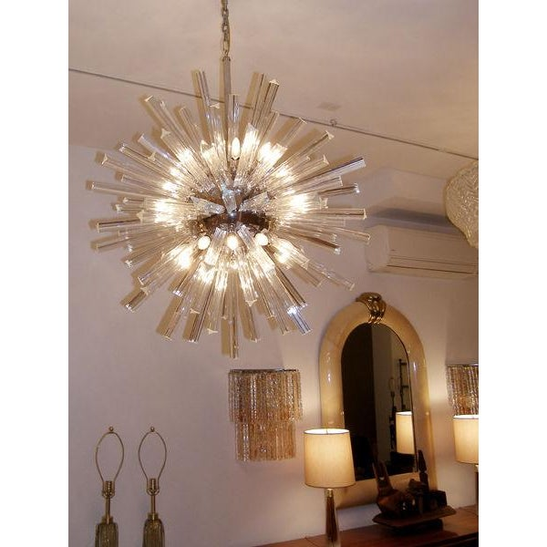 Crystal and nickel snowflake chandelier with polished nickel hardware.