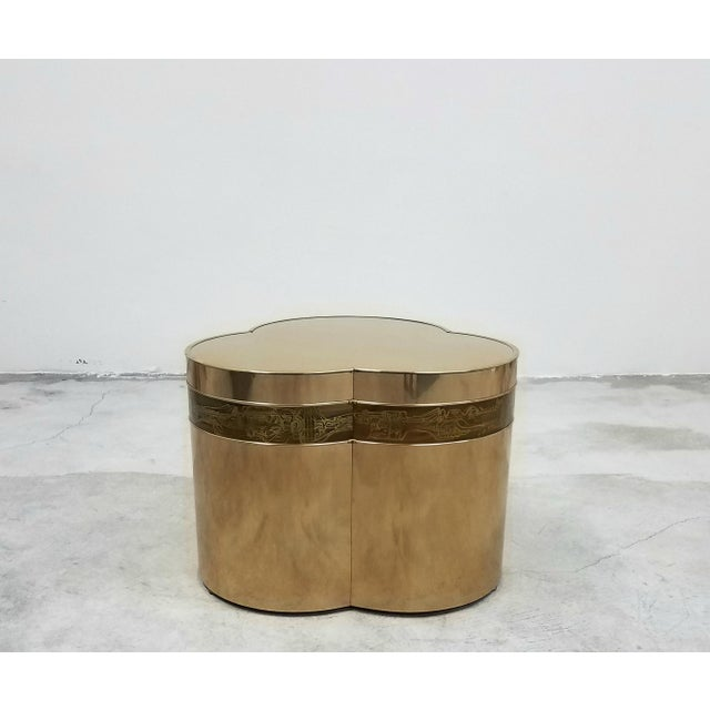 A beautiful trefoil shaped bronze side table with acid etched details characteristic of Bernhard Rohne pieces. A unique...