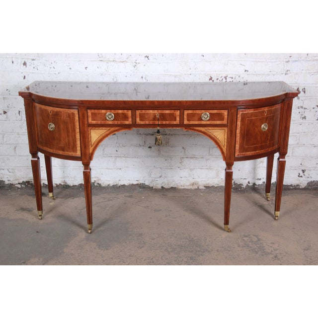 A truly rare and exceptional Sheraton bow-fronted mahogany sideboard from the exclusive Stately Homes Collection by Baker...