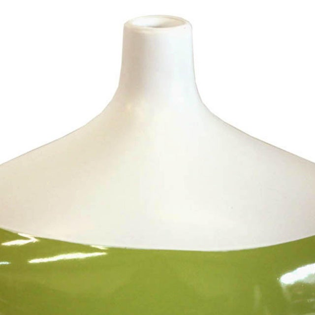 Contemporary ceramic green and white vase. Would look great on a mantle or coffee table.