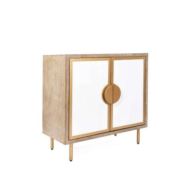 Sleek and sophisticated, our Positano Accent Cabinet frames richly-grained wood with polished gold legs for a handsome...