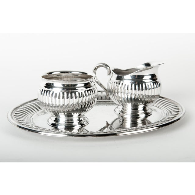 """Vintage three piece silver plated creamer and sugar set in excellent condition. Measures 7.5"""" L x 10.5"""" W x 3"""" H."""