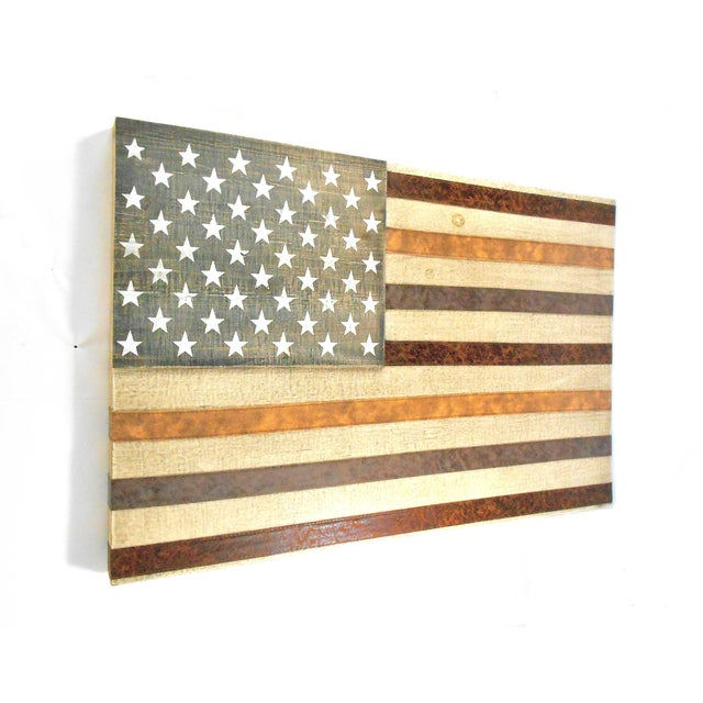 Beautiful and rustic, this American Flag wall art is constructed of solid wood. The stripes are made of leather, three...