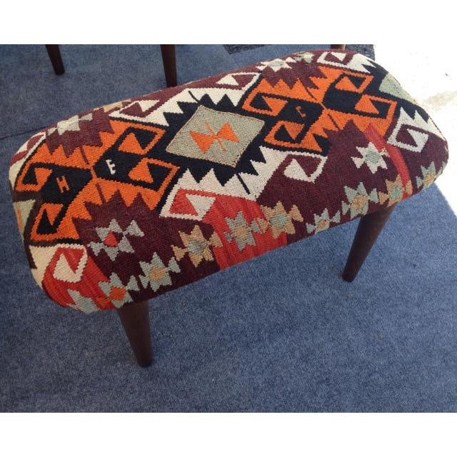 Hand woven Kilim covered bench. Rich colors and design. Weaver's Intitials are woven into the design. This would make a...