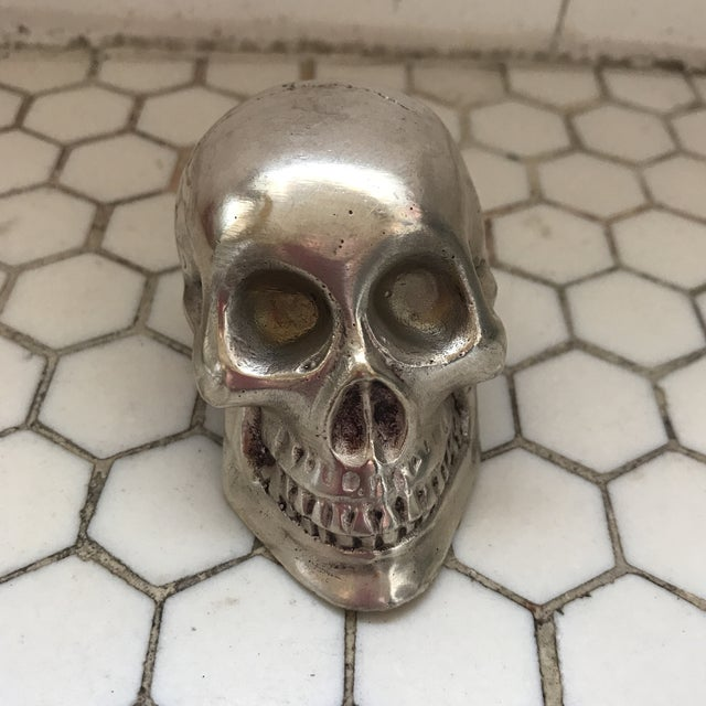 Vintage cast nickel silver metal skull.